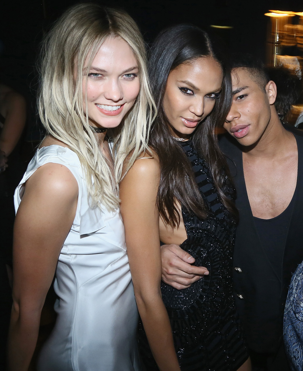 """PARIS, FRANCE - MARCH 03: Karlie Kloss, Joan Smalls and Olivier Rousteing attend the Balmain Aftershow Party as part of Paris Fashion Week Womenswear Automn/Winter 2016 at Restaurant Laperouse on March 3, 2016 in Paris, France. (Photo by Victor Boyko/WireImage)"""