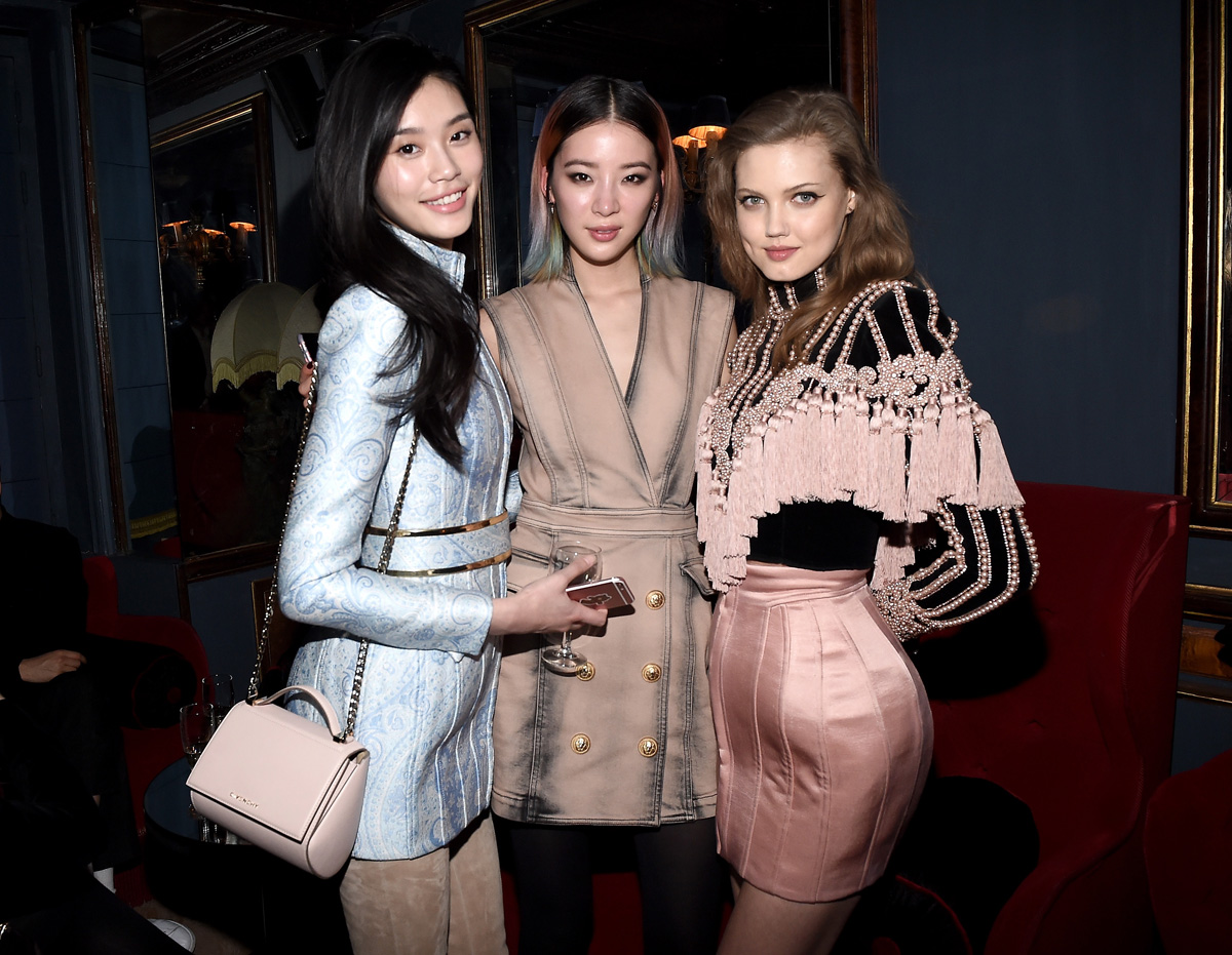 """PARIS, FRANCE - MARCH 03: (L-R) Ming Xi, Irene Kim and Lindsey Wixson attend Balmain Aftershow Party as part of Paris Fashion Week Womenswear Automn/Winter 2016 at Restaurant Laperouse on March 3, 2016 in Paris, France. (Photo by Jacopo Raule/WireImage)"""